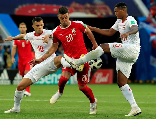 Soccer Football - World Cup - Group E - Serbia vs Switzerland - Kaliningrad Stadium, Kaliningrad, Russia - June 22, 2018 Serbia's Sergej Milinkovic-Savic in action with Switzerland's Granit Xhaka and Manuel Akanji REUTERS/Gonzalo Fuentes TPX IMAGES OF THE DAY