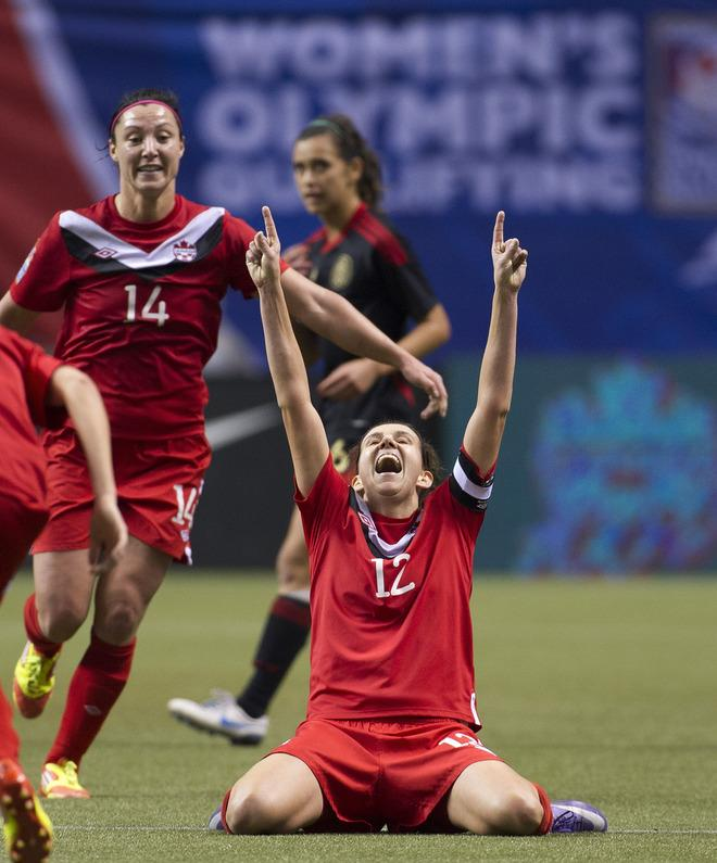 VANCOUVER, CANADA - JANUARY 27:  Christine Sinclair #12 of Canada celebrates with teammates Melissa Tancredi #14 at the final whistle after defeating Mexico 3-1 in the semifinals of the 2012 CONCACAF WomenÕs Olympic Qualifying Tournament at BC Place on January 27, 2012 in Vancouver, British Columbia, Canada. Canada qualifies for the 2012 Summer Olympic Games with the win.  (Photo by Rich Lam/Getty Images)