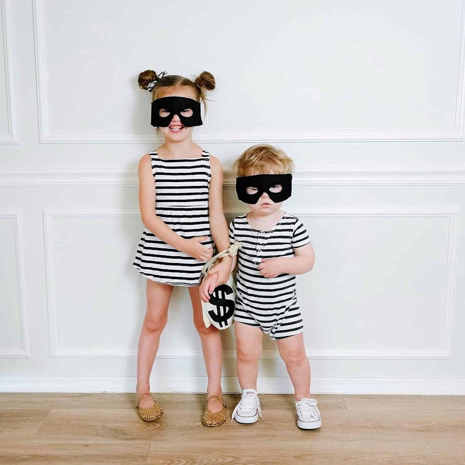 """<p>This cute costume will steal everyone's hearts. Plus, it's as easy to put together as finding a <a href=""""https://www.amazon.com/GORLYA-Backless-Elastic-Pleated-Pockets/dp/B07NZMC8R1/?tag=syn-yahoo-20&ascsubtag=%5Bartid%7C10055.g.33300912%5Bsrc%7Cyahoo-us"""" rel=""""nofollow noopener"""" target=""""_blank"""" data-ylk=""""slk:striped dress"""" class=""""link rapid-noclick-resp"""">striped dress</a> and felt mask. </p><p> <a class=""""link rapid-noclick-resp"""" href=""""https://www.amazon.com/2Pcs-Superhero-Masks-Black-Adjustable/dp/B07JYKYDMR/?tag=syn-yahoo-20&ascsubtag=%5Bartid%7C10055.g.33300912%5Bsrc%7Cyahoo-us"""" rel=""""nofollow noopener"""" target=""""_blank"""" data-ylk=""""slk:SHOP FELT MASKS"""">SHOP FELT MASKS</a></p><p><em><a href=""""https://arinsolangeathome.com/easy-last-minute-halloween-costumes/img_4147/"""" rel=""""nofollow noopener"""" target=""""_blank"""" data-ylk=""""slk:Get the tutorial at Arin Solange at Home »"""" class=""""link rapid-noclick-resp"""">Get the tutorial at Arin Solange at Home »</a></em> </p>"""