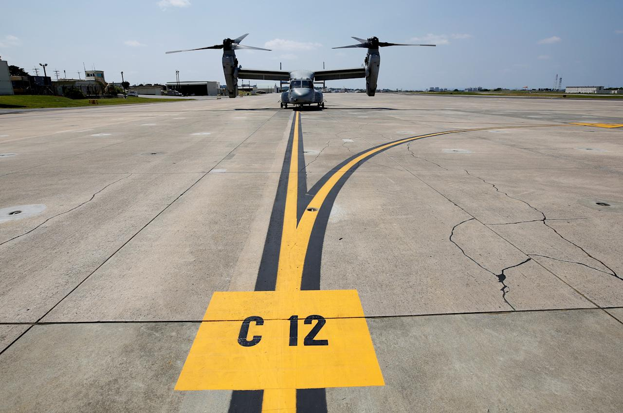 A U.S. Marine Corps MV-22 Osprey aircraft is seen at the U.S. Marine Corps' Futenma Air Station in Ginowan on Japan's southernmost island of Okinawa March 23, 2018. REUTERS/Issei Kato