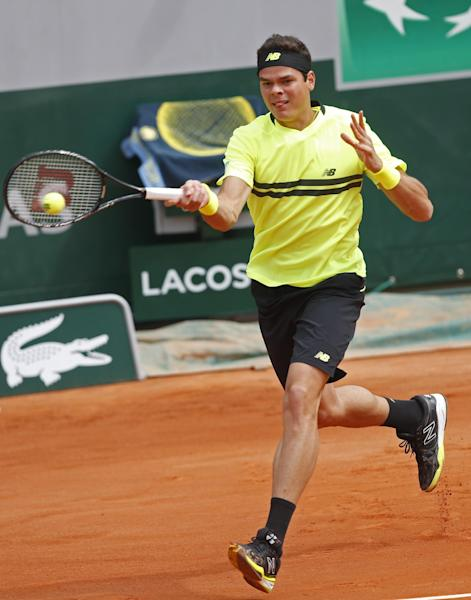 Canada's Milos Raonic returns against Belgium's Xavier Malisse in their first round match of the French Open tennis tournament, at Roland Garros stadium in Paris, Sunday, May 26, 2013. (AP Photo/Petr David Josek)