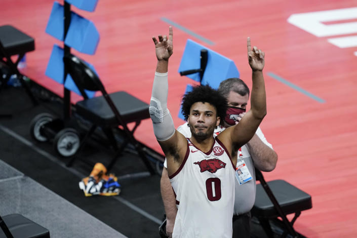 Arkansas' Justin Smith reacts to fans following a first round game against Colgate at Bankers Life Fieldhouse in the NCAA men's college basketball tournament, Friday, March 19, 2021, in Indianapolis. Arkansas defeated Colgate 85-68. (AP Photo/Darron Cummings)