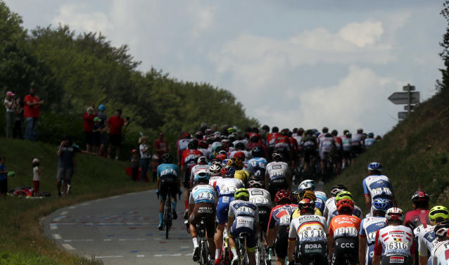 The pack rides during the seventh stage of the Tour de France cycling race over 230 kilometers (142,9 miles) with start in Belfort and finish in Chalon sur Saone, France, Friday, July 12, 2019. (AP Photo/Thibault Camus)