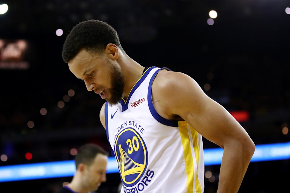 OAKLAND, CALIFORNIA - JUNE 05:  Stephen Curry #30 of the Golden State Warriors reacts against the Toronto Raptors in the first half during Game Three of the 2019 NBA Finals at ORACLE Arena on June 05, 2019 in Oakland, California. NOTE TO USER: User expressly acknowledges and agrees that, by downloading and or using this photograph, User is consenting to the terms and conditions of the Getty Images License Agreement. (Photo by Ezra Shaw/Getty Images)