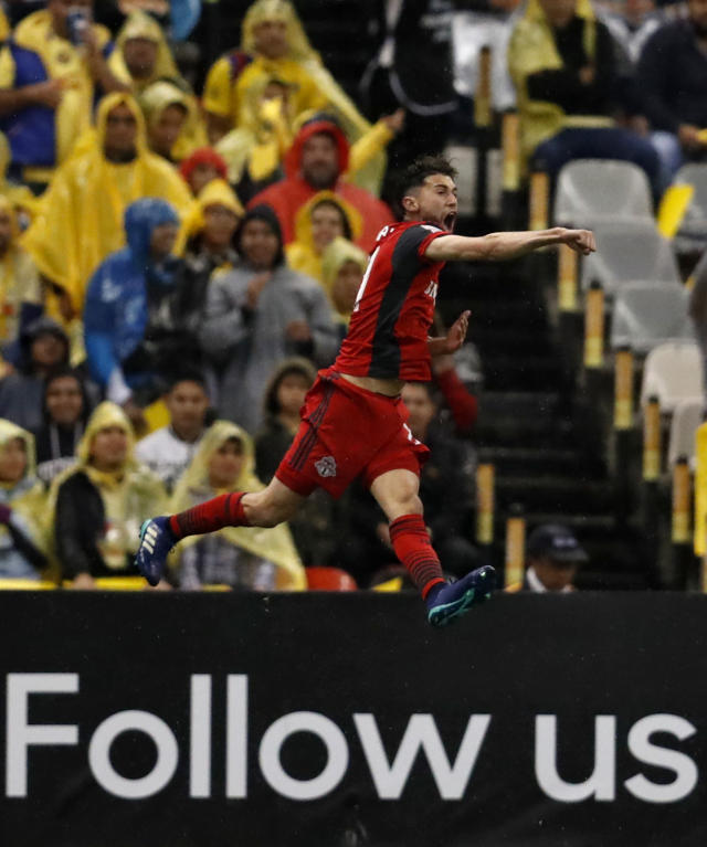 Jonathan Osorio of Canada's Toronto FC, celebrates after scoring against Mexico's America, during the second leg of a CONCACAF Champions League soccer semifinal in Mexico City, Tuesday, April 10, 2018. (AP Photo/Eduardo Verdugo)
