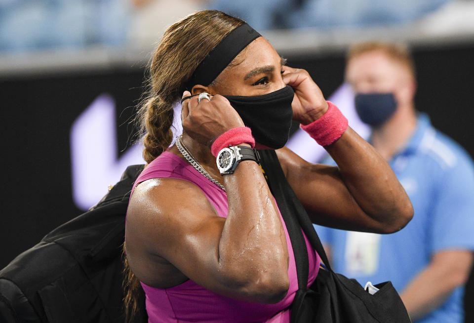 United States' Serena Williams adjusts her mask as she leaves the court following her match against compatriot Danielle Collins at a tuneup event ahead of the Australian Open tennis championships in Melbourne, Australia, Friday, Feb. 5, 2021.(AP Photo/Andy Brownbill)