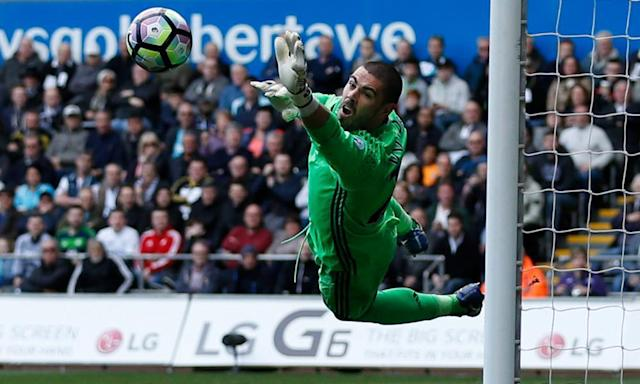 """<span class=""""element-image__caption"""">Victor Valdés makes a spectacular save for Middlesbrough in their 0-0 Premier League draw with Swansea City at the Liberty Stadium.</span> <span class=""""element-image__credit"""">Photograph: Andrew Boyers/Reuters</span>"""
