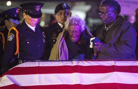 Clara Gantt the 94-year-old widow of U.S. Army Sgt. Joseph Gantt weeps in front of her her husband's casket after it was lowered from the plane before dawn on the tarmac at Los Angeles International Airport