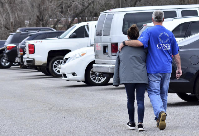 <p>Family members escort their children out of Marshal North Middle School near Palma, Ky., Jan. 23, 2018, after the students where transported from Marshal High School. (Photo: Stephen Lance Dennee/AP) </p>
