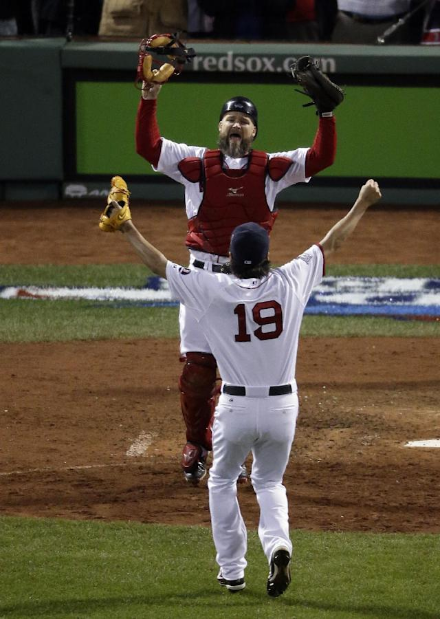 Boston Red Sox relief pitcher Koji Uehara (19) and catcher David Ross celebrate after Boston defeated the St. Louis Cardinals in Game 6 of baseball's World Series Wednesday, Oct. 30, 2013, in Boston. The Red Sox won 6-1 to win the series. (AP Photo/Charlie Riedel)