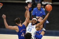 FILE - In this Dec. 1, 2020, file photo, Kentucky's Isaiah Jackson (23) grabs a rebound next to Kansas' Mitch Lightfoot (44) during an NCAA college basketball game in Indianapolis. Jackson was selected in the first round of the NBA draft Thursday, July 29. (AP Photo/Darron Cummings, File)
