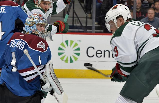 Colorado Avalanche goalie Semyon Varlamov (1), from Russia, blocks a shot by Minnesota Wild center Charlie Coyle (3) during the second period of an NHL hockey game on Saturday, Nov. 30, 2013, in Denver. (AP Photo/Jack Dempsey)