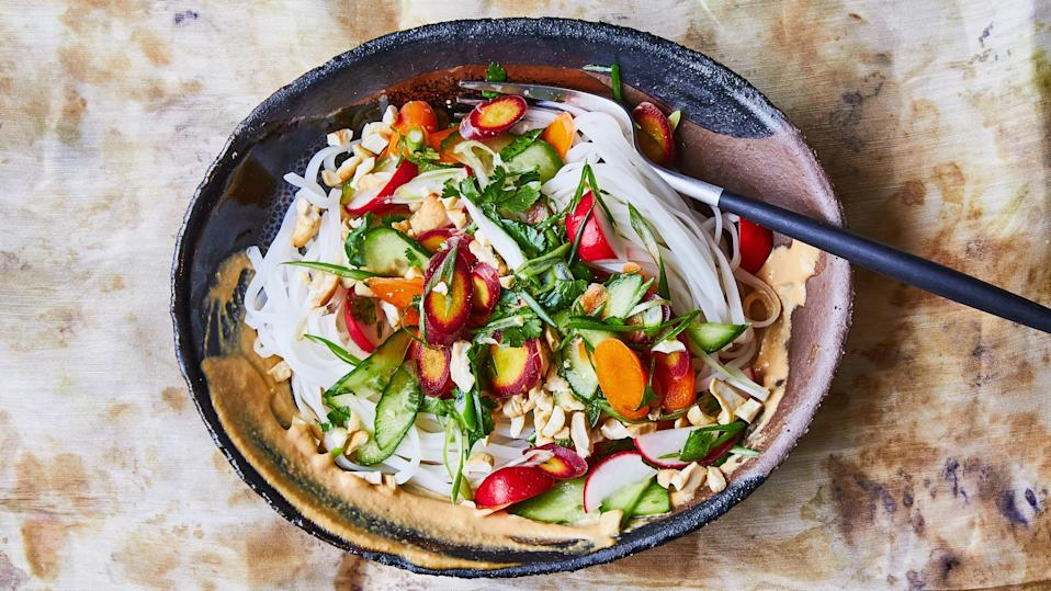 "This recipe is inspired by Gado-gado, a colorful and crunchy Indonesian salad, made with a wide array of raw and cooked vegetables (and sometimes noodles). The dressing is usually peanut-based, but we used cashews. Feel free to try another tender nut such as pistachios or pecans instead. <a href=""https://www.bonappetit.com/recipe/rice-noodles-with-cashew-sauce-and-crunchy-veg?mbid=synd_yahoo_rss"" rel=""nofollow noopener"" target=""_blank"" data-ylk=""slk:See recipe."" class=""link rapid-noclick-resp"">See recipe.</a>"
