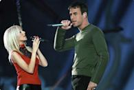 """<p>Go ahead and bask in this glorious image of Christina Aguilera and Enrique Iglesias singing some wholesome Disney song called """"Celebrate the Future Hand in Hand."""" If celebrating the future means never having to see Enrique's haircut again, I'm in. </p>"""