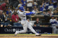 Los Angeles Dodgers' Trea Turner hits an RBI-single during the fifteenth inning of a baseball game against the San Diego Padres, Thursday, Aug. 26, 2021, in San Diego. (AP Photo/Gregory Bull)