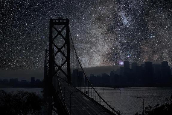 The Milky Way and California's San Francisco-Oakland Bay Bridge stand out prominently in this cityscape. The sky photo was taken in the Mojave Desert.