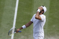 Italy's Matteo Berrettini reacts after losing a point to Serbia's Novak Djokovic during the men's singles final on day thirteen of the Wimbledon Tennis Championships in London, Sunday, July 11, 2021. (Pete Nichols/Pool Via AP)