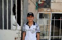 Iraqi teenager Hamid Saeed, who was mistreated by members of security forces, poses for a camera after being released from jail during an interview with Reuters at his home in Baghdad