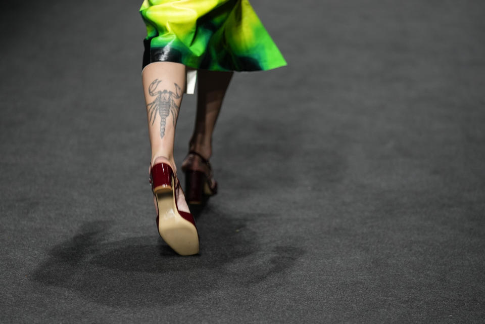 A model wears a creation for the Drome Spring Summer 2022 collection during Milan Fashion Week, in Milan, Italy, Thursday, Sept. 23, 2021. (AP Photo/Antonio Calanni)