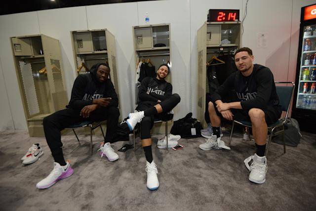 Draymond Green, Steph Curry and Klay Thompson stay loose before All-Star practice Saturday. (Getty)