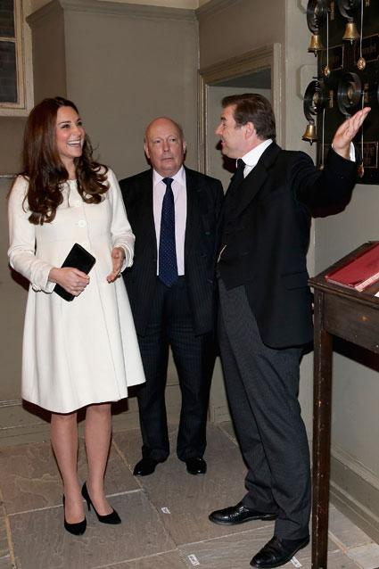 "Kate Middleton may be the beloved Duchess of Cambridge, but on Thursday, March 12, she was also a super-excited  <em>Downton Abbey</em> fan when she visited the set. Kate, 33, looked ecstatic arriving at Ealing Studios in west London where the show is taped. Sporting a cream Jojo Maman Bebe babydoll coat and black heels, the eight-months pregnant Kate was greeted by writer and show creator Lord Julian Fellowes, before visiting make-up artists, costume designers as well as production, editorial and Ealing studios staff.   Designers, seamstresses and cutters work hard to create intricate costumes for the cast @DowntonAbbey pic.twitter.com/IzIcjKpJ85— Kensington Palace (@KensingtonRoyal) March 12, 2015      The Duchess of Cambridge tours the construction workshop and prop store @DowntonAbbey #DuchessAtDownton pic.twitter.com/Ge8vtxd7k9— Kensington Palace (@KensingtonRoyal) March 12, 2015    PHOTOS: Kate Middleton's Best Fashion  She also got to watch scenes being filmed in the servants' quarters and in the ""Video Village"" area, while meeting cast members Michelle Dockery (Lady Mary), Joanne Froggatt (Anna), Hugh Bonneville (Robert), Elizabeth McGovern (Cora), Phyllis Logan (Mrs Hughes), Robert James-Collier (Thomas), Lesley Nicol (Mrs. Patmore) and Sophie McShera (Daisy Mason).    Getty Images     The #DuchessAtDownton meets Lady Mary and Anna during series 6 filming @EalingStudios pic.twitter.com/0n4Mp6youD— Kensington Palace (@KensingtonRoyal) March 12, 2015       Getty Images   Of course, the show couldn't have Kate leave without a few unique gifts to remember her visit. She was adorably presented a wooden train for her one-year-old son -- Prince George -- by Master George Crawley himself, who was accompanied by Dockery, his on-screen mother.   George hands The Duchess a wooden train for Prince George #DuchessAtDownton @EalingStudios pic.twitter.com/vRHwhkSIkK— Kensington Palace (@KensingtonRoyal) March 12, 2015    A delicious chocolate cake given to her by Nicol and McShera was also part of the festivities.   Mrs Patmore @lesley_nicol and Daisy baked a delicious chocolate cake to commemorate today's visit to @DowntonAbbey pic.twitter.com/HyhGHb8iia— Kensington Palace (@KensingtonRoyal) March 12, 2015    Finally, the unveiling of a plaque to commemorate the visit and an official photograph with cast members, writers and producers finished off her eventful visit.    Getty Images   NEWS: Kate Middleton Is the Latest Victim of a Photoshop Fail  In November, Kate and Will actually met British boy band One Direction before the Royal Variety Performance in London. Watch the cute moment in the video below!"