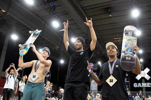 Silver medalist Jagger Eaton of USA, gold medalist Kelvin Hoefler of Brazil and bronze medalist Felipe Gustavo of Brazil celebrate after the X Games Men's Skateboard Street final in Oslo, Norway May 20, 2018. NTB Scanpix/Fredrik Hagen/via REUTERS ATTENTION EDITORS - THIS IMAGE WAS PROVIDED BY A THIRD PARTY. NORWAY OUT. NO COMMERCIAL OR EDITORIAL SALES IN NORWAY.