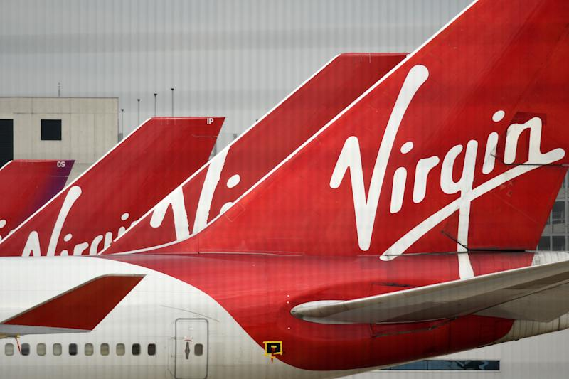 Virgin Atlantic Airline planes are pictured at the apron at Manchester Airport in north-west England, on June 8, 2020, as the UK government's planned 14-day quarantine for international arrivals to limit the spread of the novel coronavirus begins. (Photo by Oli SCARFF / AFP) (Photo by OLI SCARFF/AFP via Getty Images)