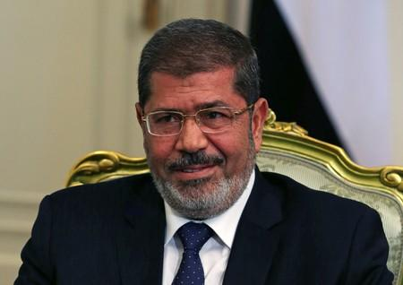 FILE PHOTO: Egypt's President Mursi participates in a meeting with U.S. Defense Secretary Panetta at the presidential palace in Cairo