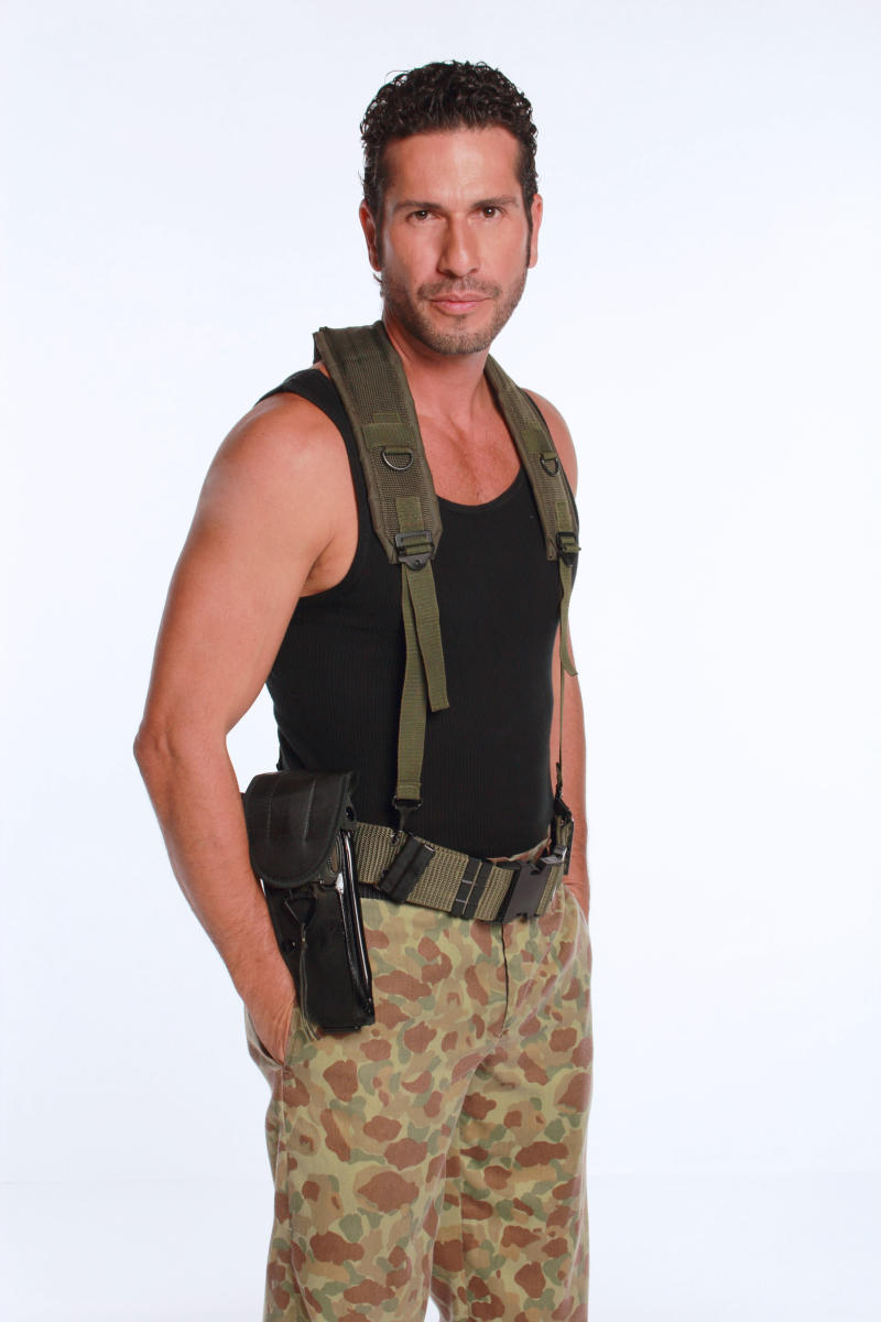 """FILE - In this 2012 promotional file photo provided by RCN Television, actor Gregoria Pernia poses in character as Fidel Castano for the television series """"Tres Caines,"""" or """"Three Cains,"""" an allusion to the Biblical story of Cain slaying his brother Abel, in Bogota, Colombia.  The soap opera has stirred unprecedented controversy by dramatizing _ and some say romanticizing _ the career of the Castano brothers, central figures in the creation of the country's murderous far-right militias. (AP Photo/RCN Television, File)"""