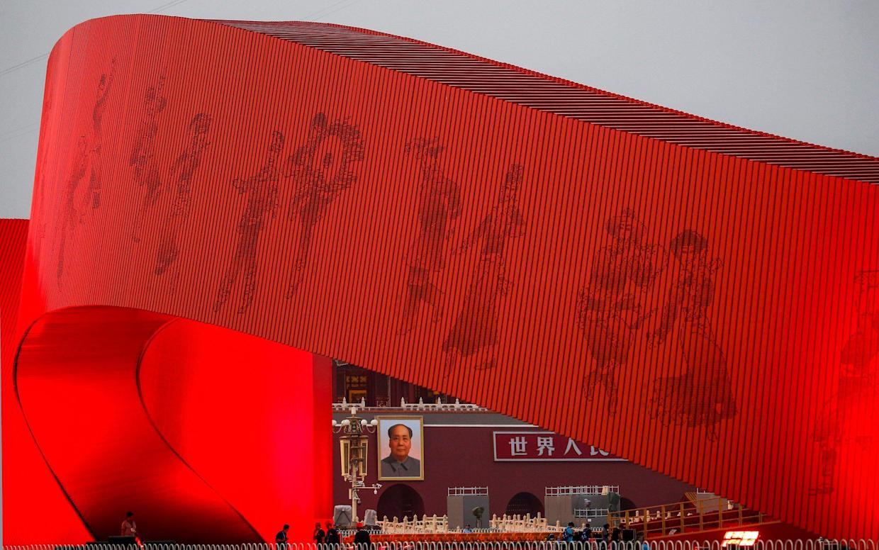 Tiananmen Square is prepared for the parade for the 70th anniversary of the People's Republic of China - AP