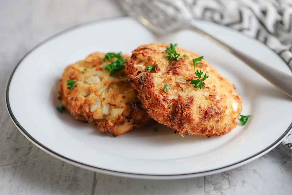 """<p>No fear, an easy crab cake recipe is here! Made with fresh crab, onions, bread crumbs, and a dash of mayo, these crispy cakes are an easy appetizer any night of the week. Top them off with a bit of fresh parsley and some dipping sauce, and you're ready to roll.</p> <p><strong>Get the recipe</strong>: <a href=""""https://cookswithsoul.com/air-fryer-crab-cakes/"""" class=""""link rapid-noclick-resp"""" rel=""""nofollow noopener"""" target=""""_blank"""" data-ylk=""""slk:air fryer crab cakes"""">air fryer crab cakes</a></p>"""