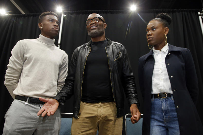 "Mixed martial arts great Anderson ""Spider"" Silva of Brazil, daughter Kaory, 23, right, and son Kalyl, 20, left, talk to reporters after all were sworn in as U.S. citizens in a mass naturalization ceremony Tuesday, July 23, 2019 at the Los Angeles Convention Center. (AP Photo/Reed Saxon)"