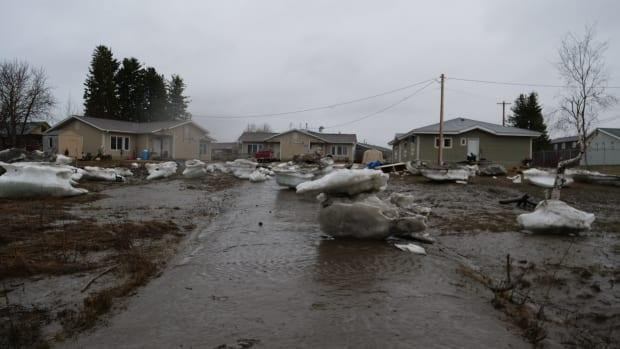 Ice litters a road in Fort Simpson in the aftermath of flooding resulting from the spring break-up on the Mackenzie River.