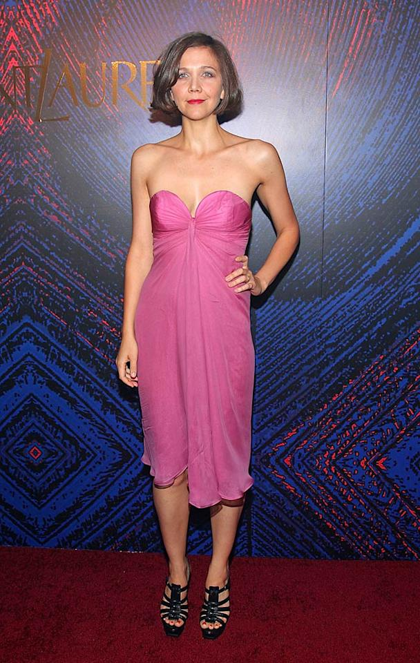 """Maggie Gyllenhaal was pretty in a pink chiffon dress which she paired with Yves Saint Laurent heels. Mike Coppola/<a href=""""http://www.wireimage.com"""" target=""""new"""">WireImage.com</a> - June 17, 2010"""