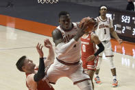 Illinois center Kofi Cockburn (21) comes down with the ball as Wisconsin's forward Micah Potter defends in the second half of an NCAA college basketball game Saturday, Feb. 6, 2021, in Champaign, Ill. (AP Photo/Holly Hart)