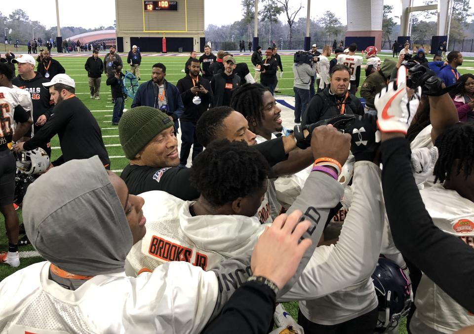 Pro Football Hall of Famer Aeneas Williams (green cap) was coaching the Senior Bowl South Team's defensive backs, and many had no idea who he was. (Eric Edholm/Yahoo Sports)
