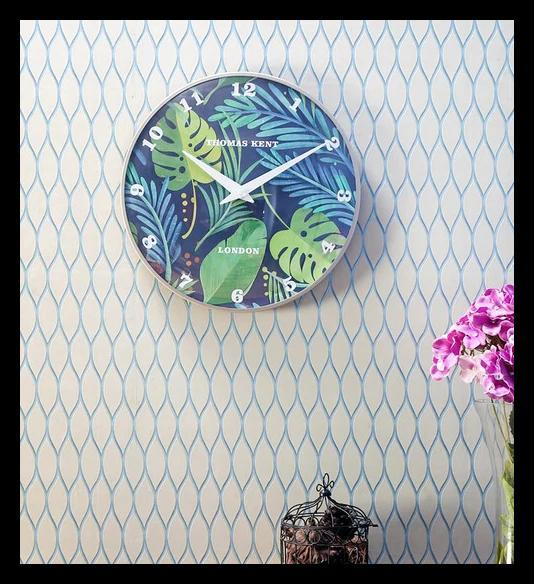 "The <a href=""https://fave.co/2IPG4NL"">Tropical Wall Clock</a> from Thomas Kent is a reminder of time well spent on dreamy summer vacations. Diameter: 14"". <em>Rs. 1,599 on offer.</em>"