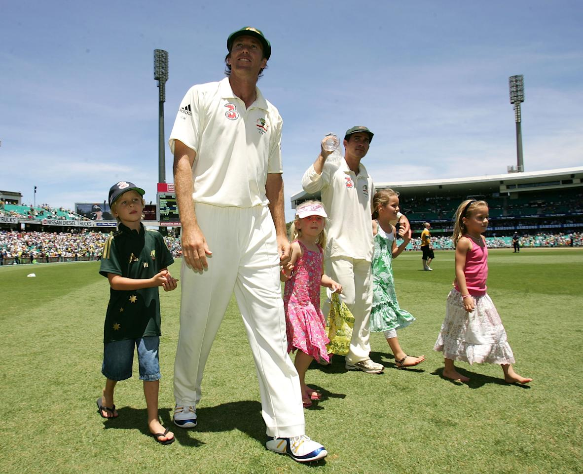 SYDNEY, AUSTRALIA - JANUARY 05:  Glenn McGrath of Australia walks with his son James (L) and daughter Holly (2nd L) and team mate Justin Langer (4th L) with his children as they do a lap of honour after day four of the fifth Ashes Test Match between Australia and England at the Sydney Cricket Ground on January 5, 2007 in Sydney, Australia.  (Photo by Tom Shaw/Getty Images)