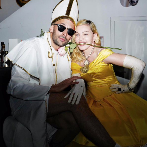 "<p>At one point during the party, Madonna's mask came off while she chatted up artist JR, who was outfitted as clergy. She had a rose in her mouth (we're not sure if it was an enchanted one or not!) in this photo. (Photo: <a rel=""nofollow"" href=""https://www.instagram.com/p/BRijyD4ABLM/?taken-by=madonna&hl=en"">Instagram</a>) </p>"