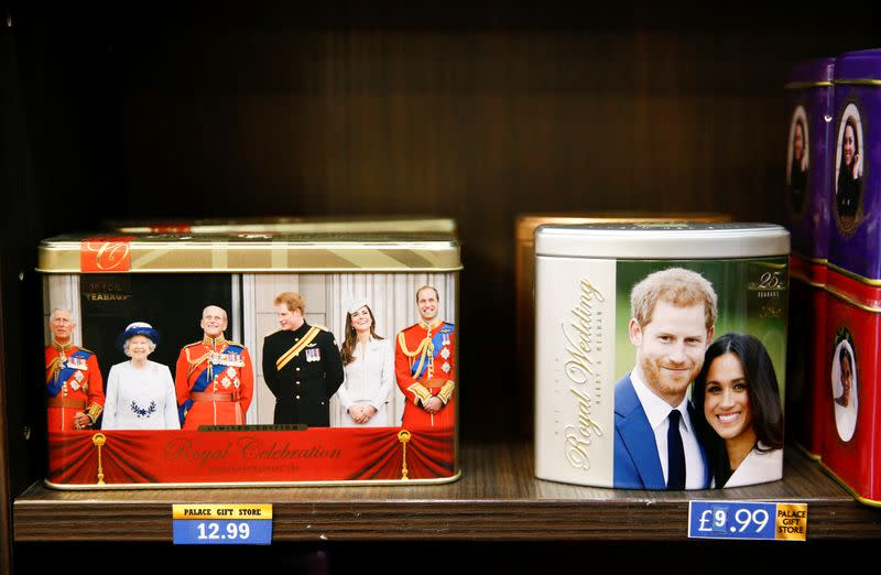 Merchandise depicting Britain's Prince Harry and Meghan, Duchess of Sussex, are seen on display in a souvenir shop near Buckingham Palace in London