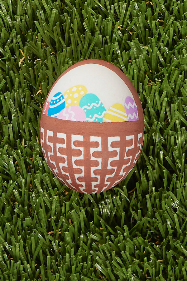 <p>Here's a project for a steady hand: Use fine-tipped paint pens or brushes in brown to paint a wicker basket onto your egg. Fill that basket with teeny painted eggs. So pretty. And so meta!</p>