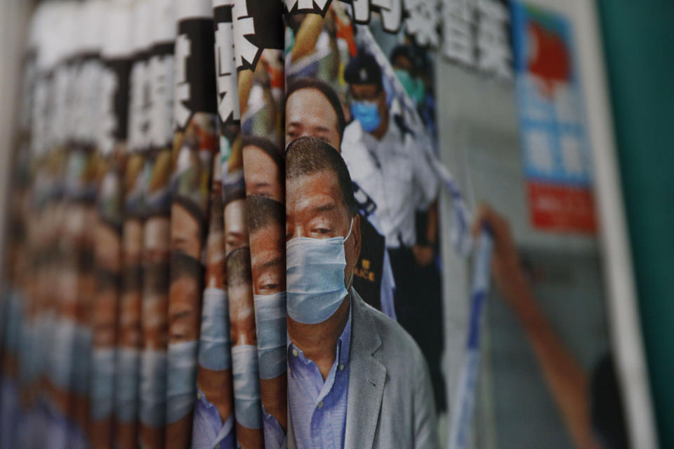 """Copies of Apple Daily newspaper with front pages featuring Hong Kong media tycoon Jimmy Lai, are displayed for sale at a newsstand in Hong Kong Tuesday, Aug. 11, 2020. A year ago, the pro-democracy Apple Daily newspaper published a front-page headline saying Hong Kong's governing principle of """"one country, two systems is dead."""" On Thursday, June 17, 2021, the newspaper was facing its greatest peril. Three top editors and two senior executives were arrested under Hong Kong's new national security law. (AP Photo/Kin Cheung, File)"""