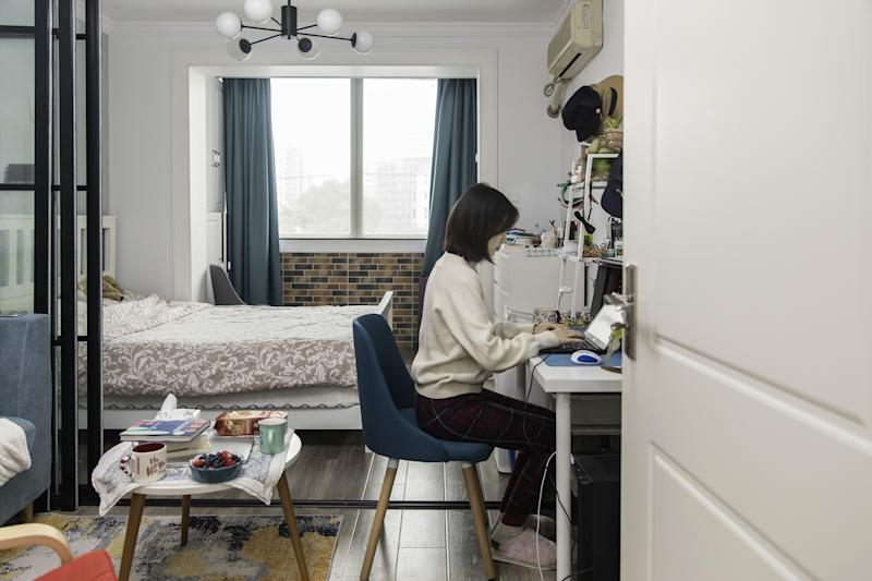 Image: An employee works from her home in Shanghai (Qilai Shen / Bloomberg via Getty Images)