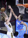 Indiana Pacers' Domantas Sabonis drives to the basket against Houston Rockets' Kelly Olynyk during the third quarter of an NBA basketball game Wednesday, April 14, 2021, in Houston. (Carmen Mandato/Pool Photo via AP)