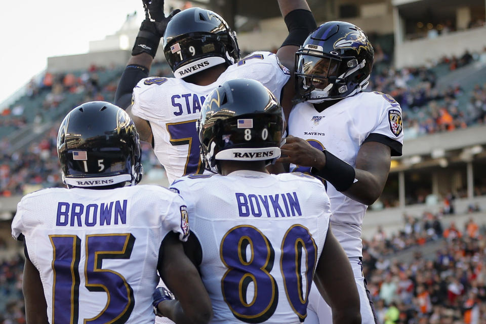 Baltimore Ravens quarterback Lamar Jackson, right, celebrates his touchdown during the second half of NFL football game ==, Sunday, Nov. 10, 2019, in Cincinnati. (AP Photo/Frank Victores)
