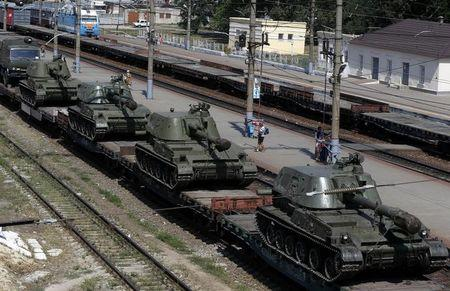A freight car loaded with self-propelled howitzers is seen at a railway station in Kamensk-Shakhtinsky, Rostov region, near the border with Ukraine
