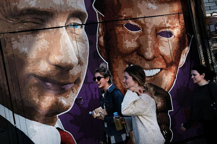 <p>A mural depicting a winking Vladimir Putin taking off his Donald Trump mask is painted on a storefront outside of the Levee bar in Brooklyn on February 25, 2017 in New York City. (Photo: Spencer Platt/Getty Images) </p>