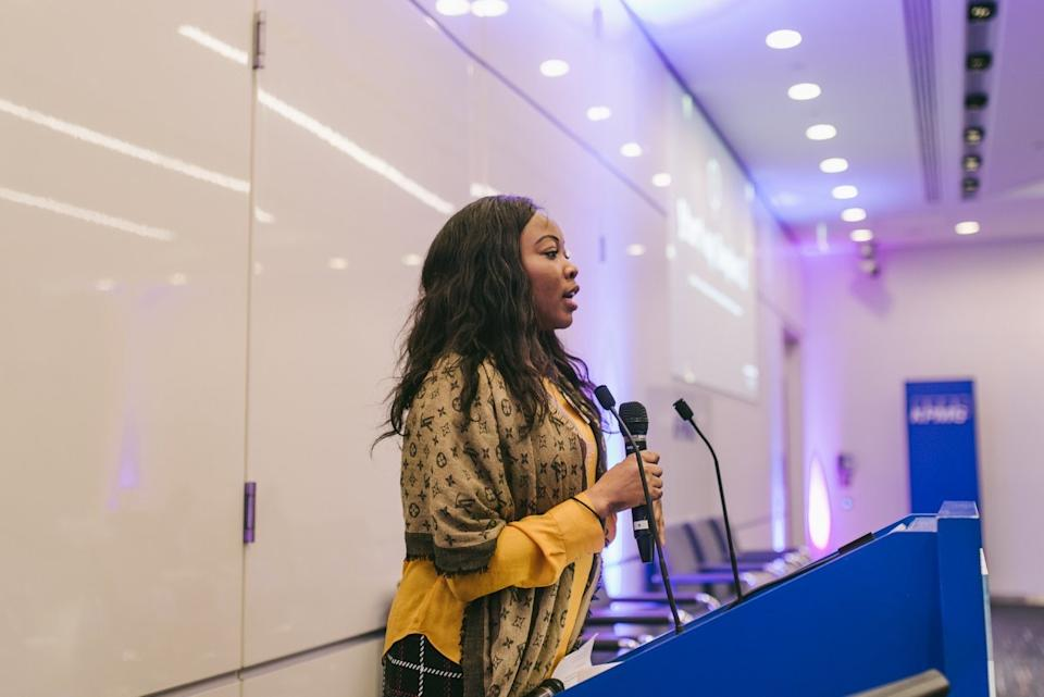 Mary Agbesanwa speaking at an event.