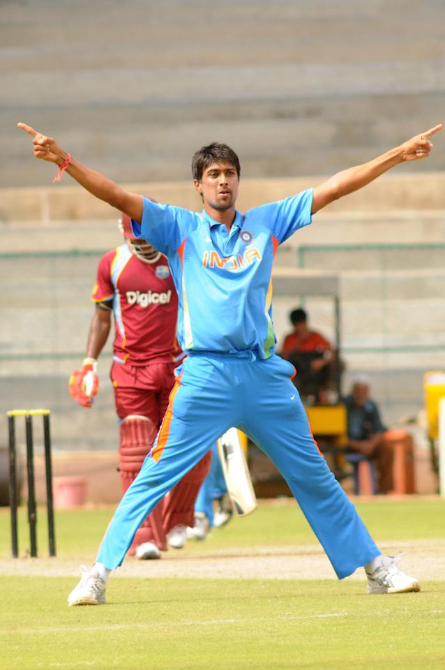 Rahul Sharma of India A team celebrates after the wicket of West Indies A team, he took 5 wickets against West Indies A team, during  India A team v/s West Indies A team unofficial T-20 cricket match at Chinnaswamy Stadium, in Bangalore on Saturday 21st of Sept. 2013. (Photo: IANS)