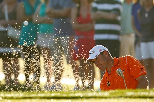 PALM BEACH GARDENS, FL - MARCH 02: Lee Westwood of England hits out of the bunker on the tenth hole during the second round of the Honda Classic at PGA National on March 2, 2012 in Palm Beach Gardens, Florida. (Photo by Mike Ehrmann/Getty Images)